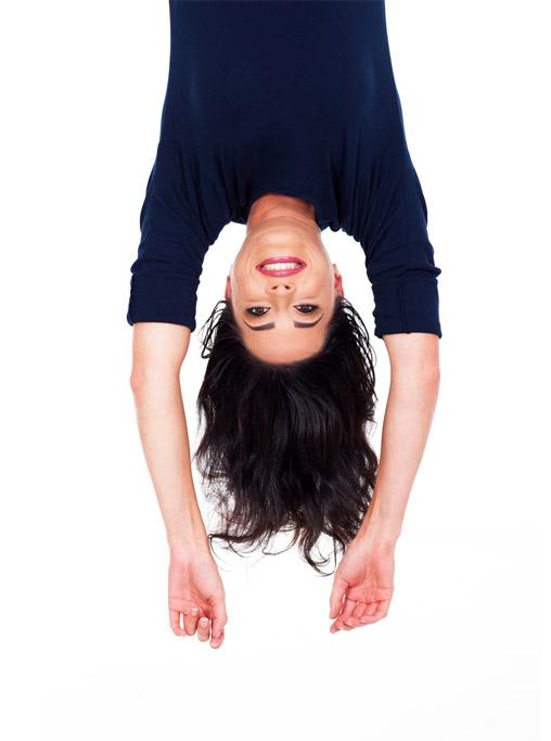 pretty young woman upside down portrait on white
